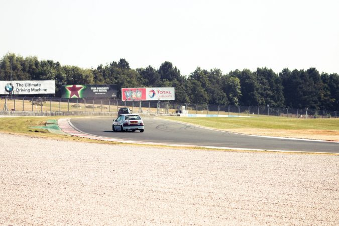 Citroen Saxo and Peugeot 106 racing around the first corner