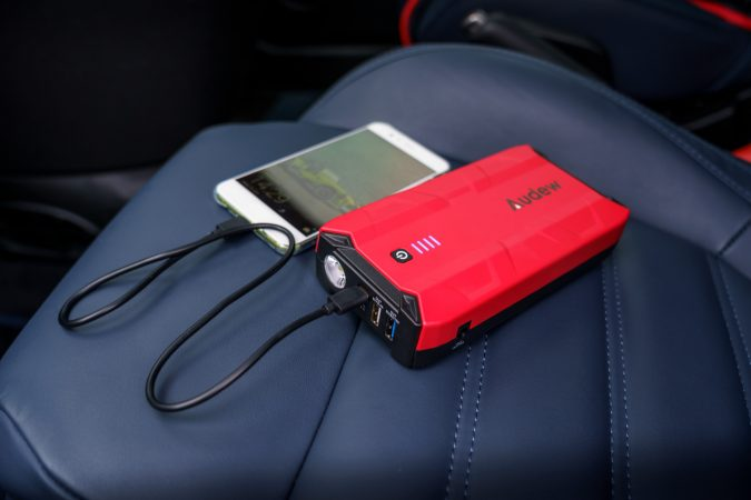 audew car jump starter charging a phone
