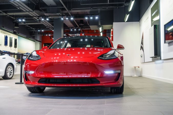 Tesla Model 3 In Store Front Red
