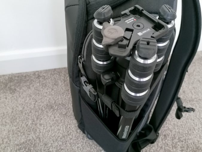 You could put tripods along the side pockets.