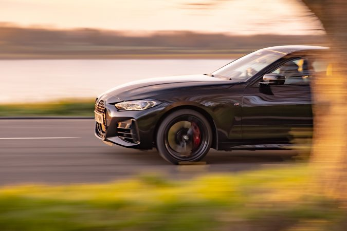 BMW M440i xDrive Coupe Driving on road
